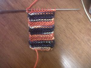 This little rectangle of garter stitch will become the sole of the bootie. Like those Bronco colors?