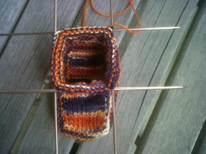 Knitting the rounds of the ankle of the bootie.