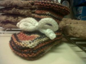 Finished bootie with the cookies I baked while knitting the ankle.