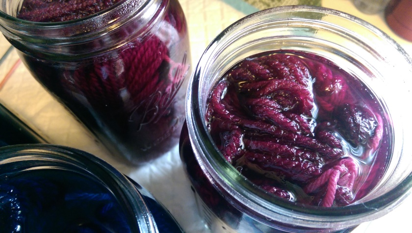 Dyed yarn in jars.