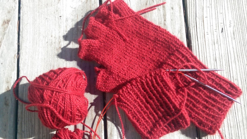 Red alpaca half gloves.