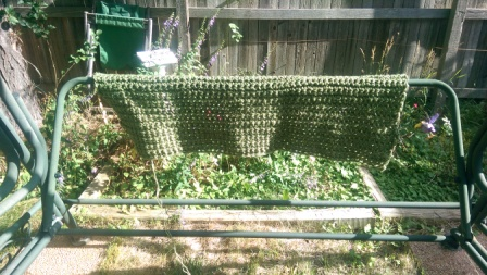 Crocheted lawn seat.