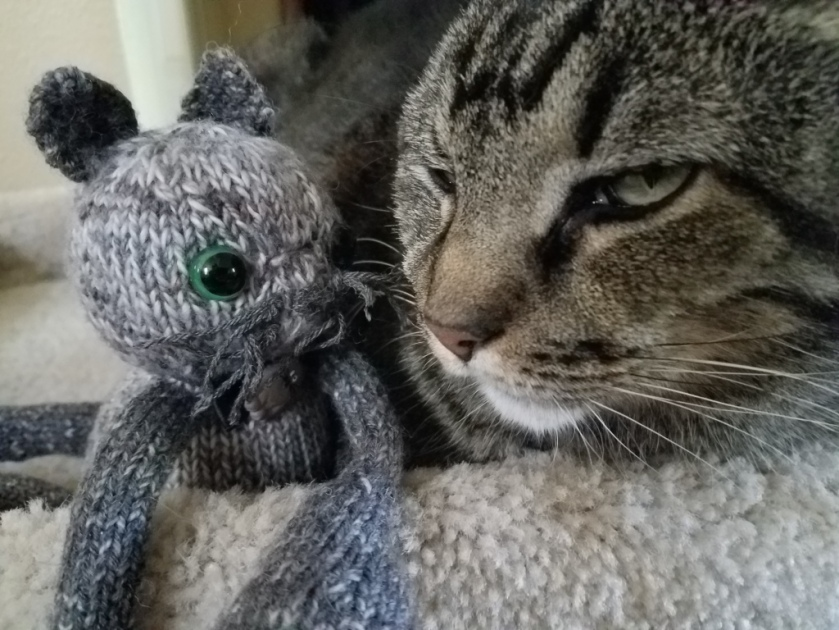 Cat and knitted cat.