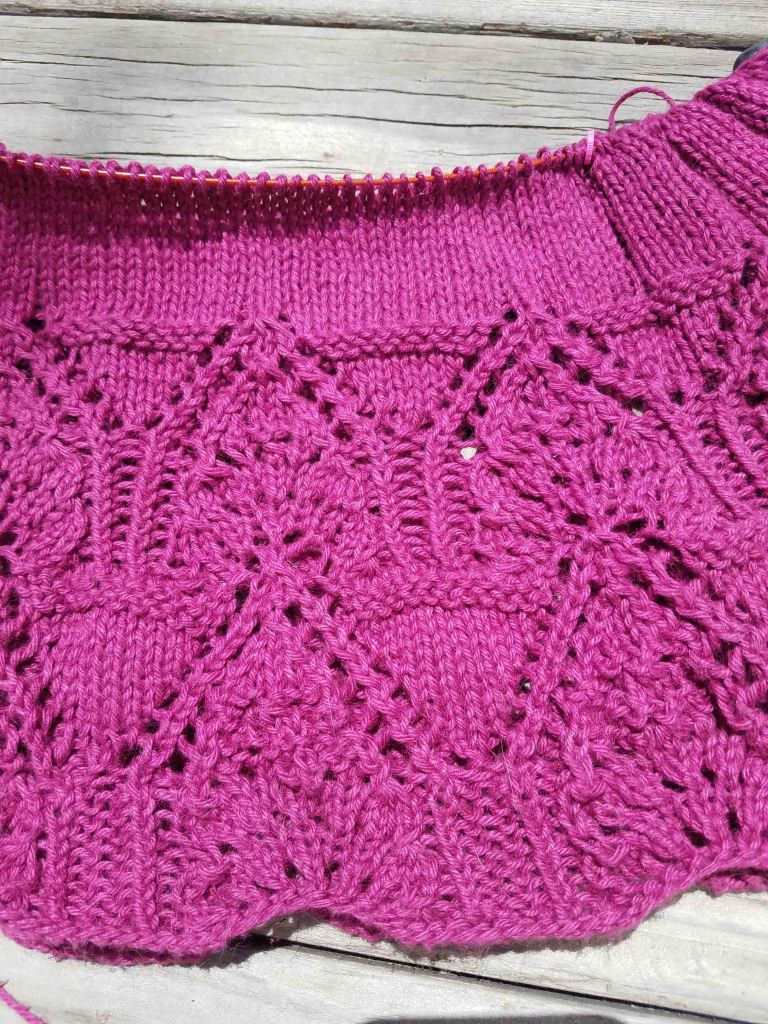 Lace detail on knitting.