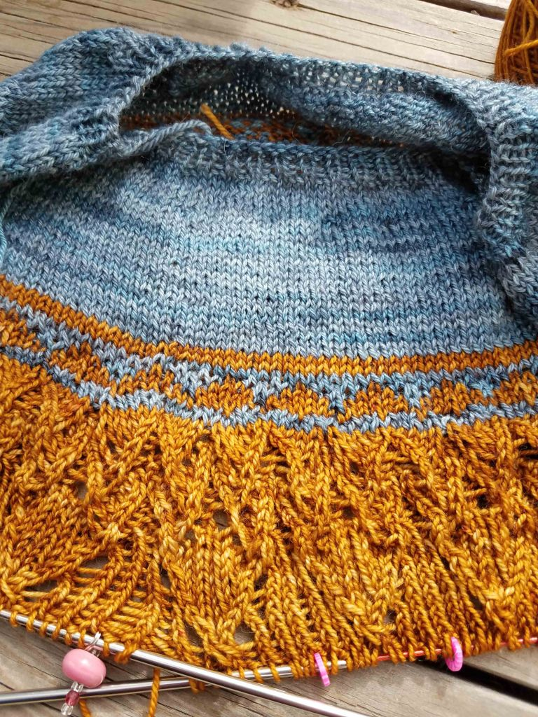 Lace detail of the knitting.