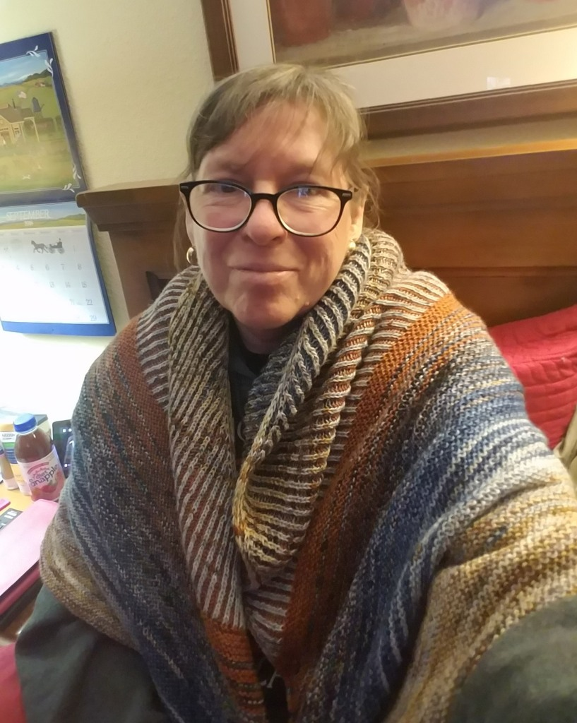 Author wearing an hand knit shawl.