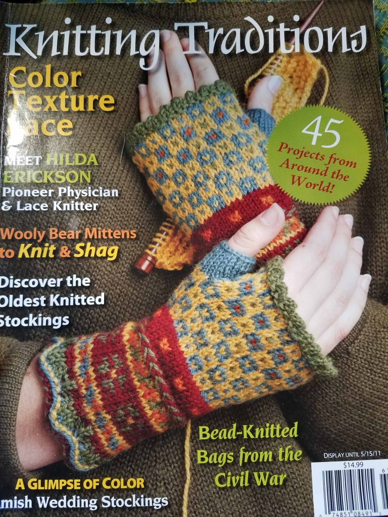 Mitts on magazine cover.